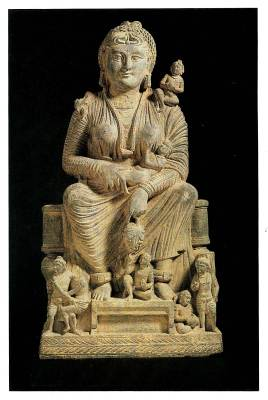 This Gandharan masterpiece, carved in a warm-toned schist, portrays Hariti  as the epitome of maternal grace, a regal yet figure.