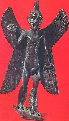 Bronze amulet figurine of the Mesopotamian demon Pazuzu, with the feet and claws of an eagle and a monster head, partly of a lion. Musee du Louvre, Paris