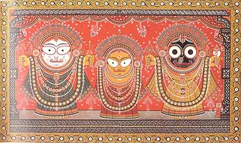 The Jagannatha trinity, Balarama, Subhadra, and Krishna, in the ceremonial king costume with attached golden limbs (raja vesha)