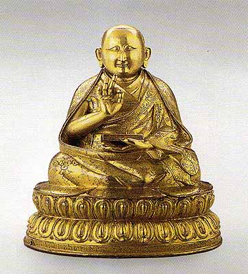 """The Second Dalai Lama. Bronze, gilded, with inscription on the reverse: """"The valuable omniscient Victorious Lord"""" Tibet, 16th century."""