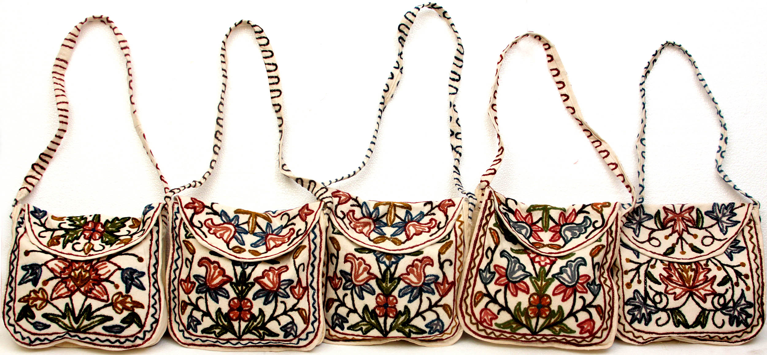 Lot of five flapped handbags with crewel embroidery from