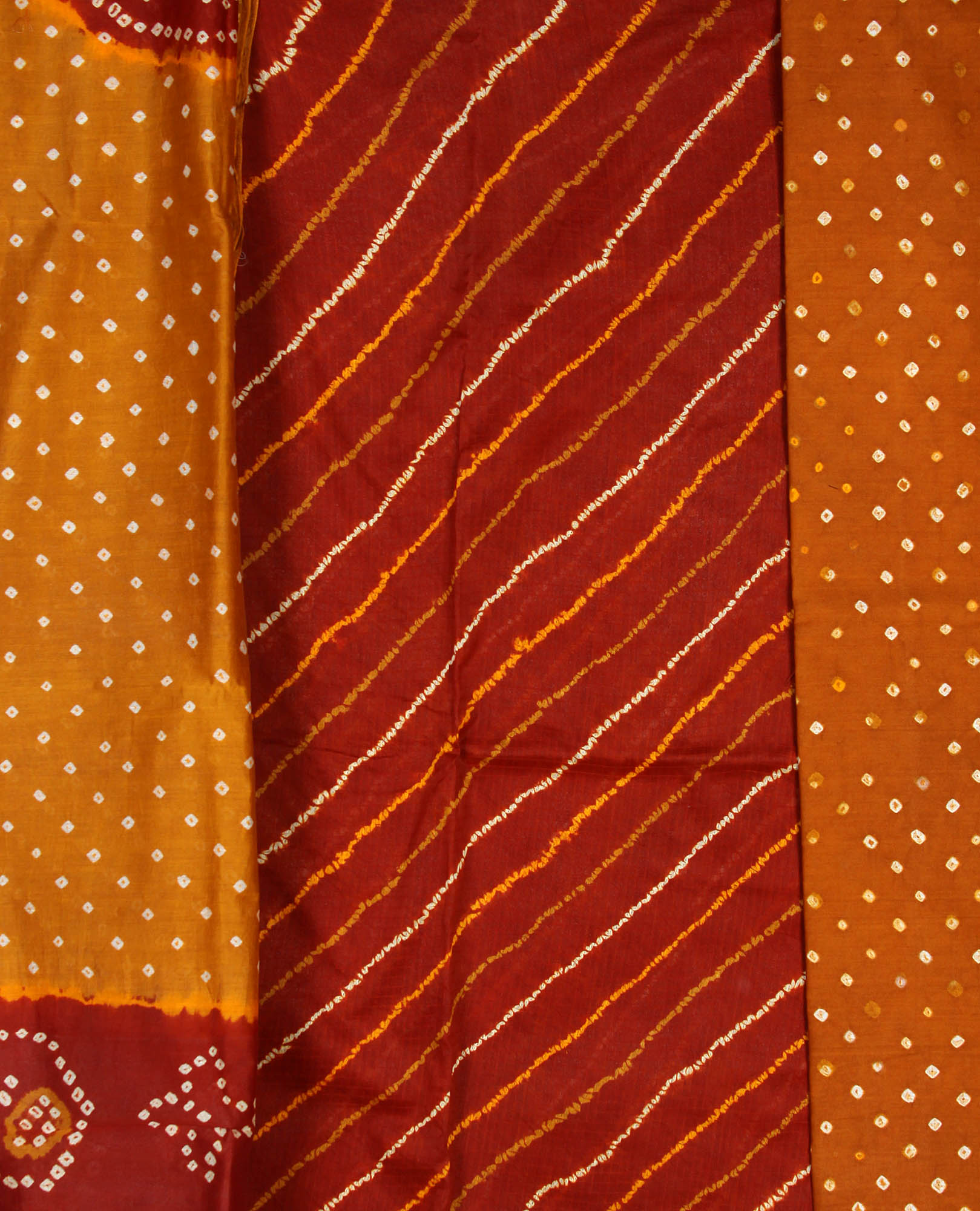 Caramel and rust bandhani tie dye suit from kutch with tissue border - Tie and dye tissu ...