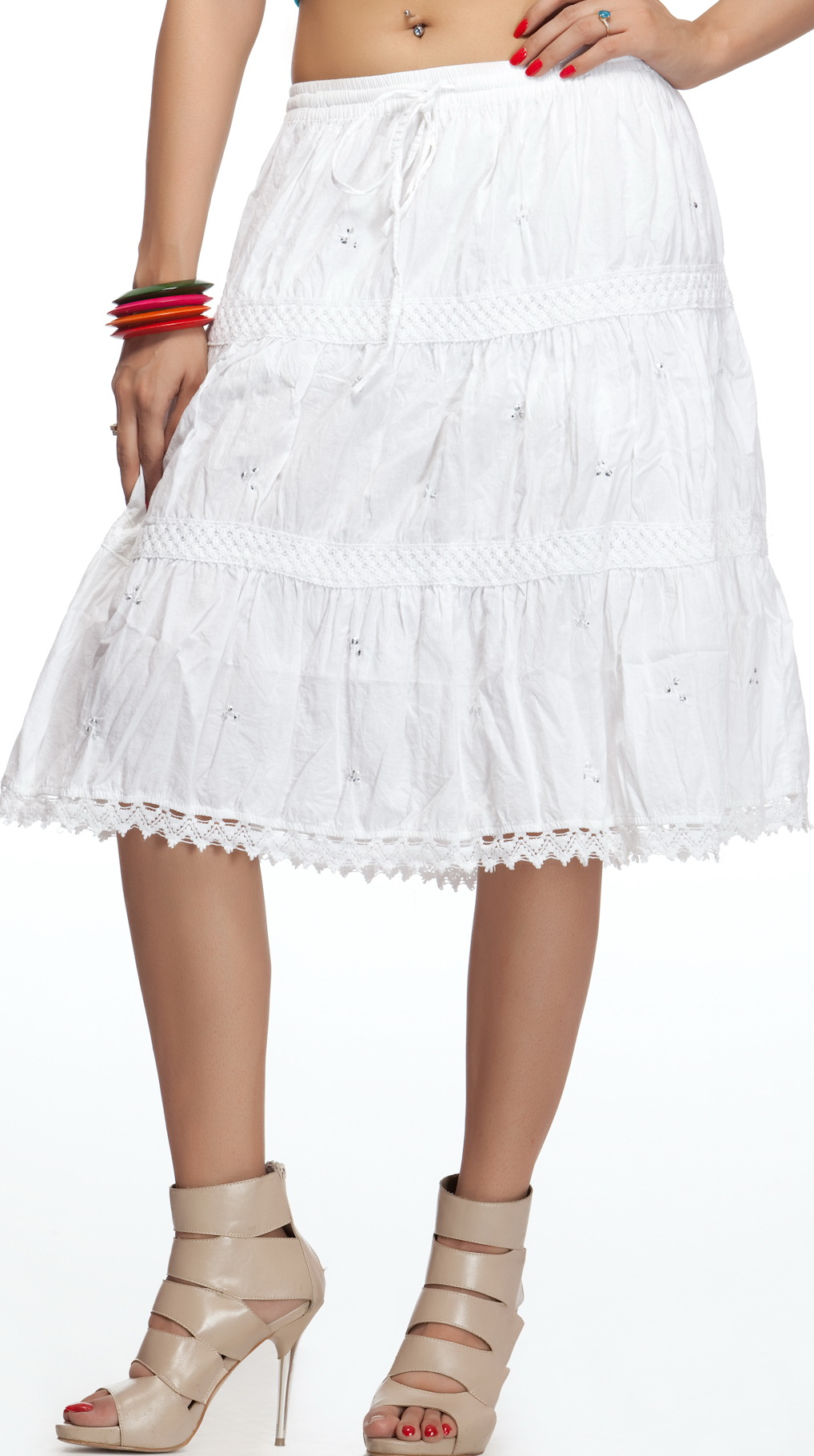 Choose your little white dress in silky, seductive, body-hugging satin with a lace overlay, or for a more youthful, flirty look, you might like your short white dress to be a fit-and-flare dress with sequins, tulle, and a corset back.
