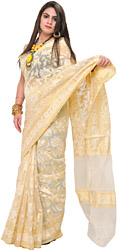 Egret-White Banarasi Net Sari With Golden Thread Weave and Flowers Woven All-Over