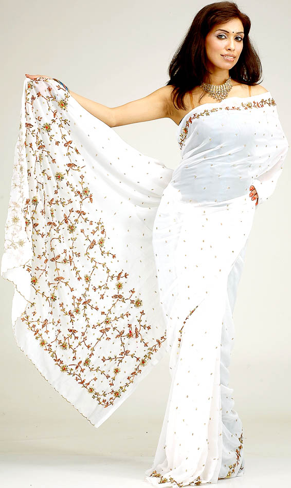 White bridal sari with sequins embroidered as creepers and for White indian wedding dress