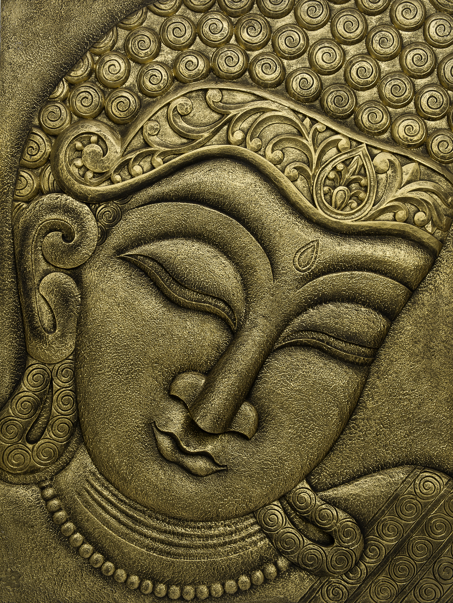 The buddha face carved in relief wall hanging