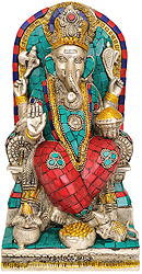 Four Armed Ganesha Seated on Throne